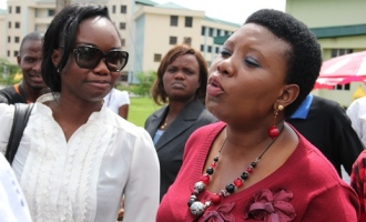 orode-uduaghan-founder-pink-pearl-foundation-on-the-walk-way-to-the-auditorium-with-toyosi-akerele-of-rise-during-the-port-harcourt-session-of-the-rise-youth-forum-2011